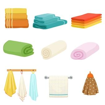 Białe i kolorowe miękkie ręczniki kąpielowe lub kuchenne.