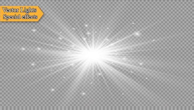 Białe iskry błyszczą specjalny efekt świetlny. błyszczy na przezroczystym tle. boże narodzenie abstrakcyjny wzór. lśniące magiczne cząsteczki pyłu