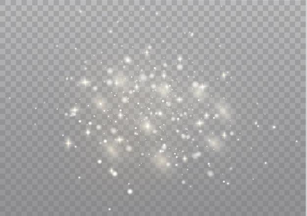 Białe iskry błyszczą specjalnym efektem świetlnym. błyszczy na przezroczystym tle. boże narodzenie abstrakcyjny wzór. lśniące, magiczne cząsteczki kurzu