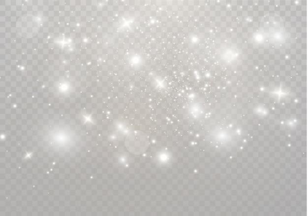 Białe iskry i złote gwiazdy błyszczą specjalnym efektem świetlnym. błyszczy na przezroczystym tle. lśniące magiczne cząsteczki pyłu.