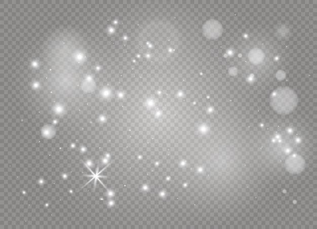 Białe iskry i złote gwiazdy mienią się specjalnym efektem świetlnym. lśniące cząsteczki czarodziejskiego pyłu, wektory błyszczą