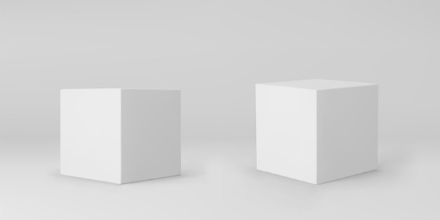 Białe kostki 3d z perspektywy na szarym tle.