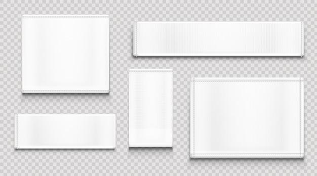 Białe metki z tkaniny, metki z tkaniny o różnych kształtach