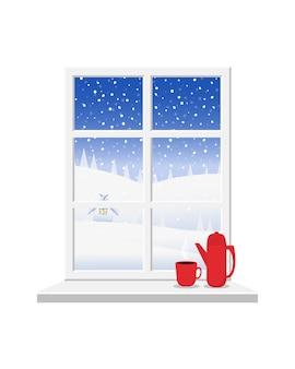 Białe okno z widokiem na zimowy krajobraz.