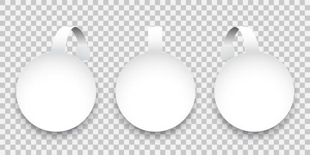 Białe okrągłe woblery papierowe na przezroczystym tle