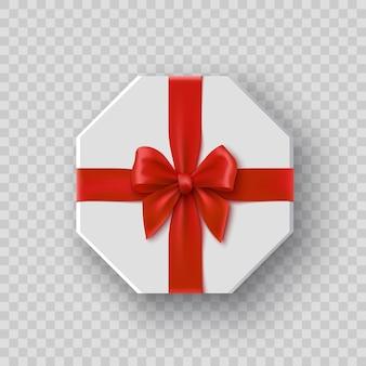 Białe ośmiokątne pudełko upominkowe z czerwoną kokardką