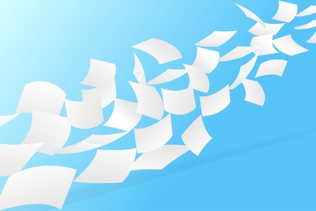 Białe papiery latające na niebieskim tle nieba.