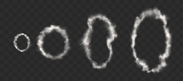 Białe pierścienie dymu z papierosa, fajki lub vape