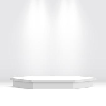 Białe podium. piedestał. sześciokątna scena z reflektorami.