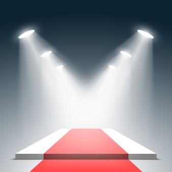 Białe podium z czerwonym dywanem i reflektorami. piedestał. .