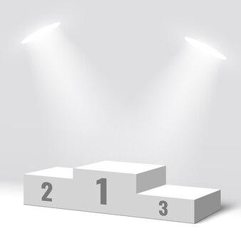 Białe podium zwycięzców i dwa reflektory. piedestał.