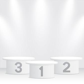 Białe podium zwycięzców z reflektorami
