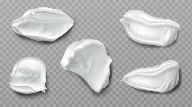 Białe próbki kremu z pianki kosmetycznej