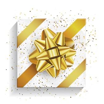 Białe pudełko z dużą złotą kokardą i konfetti. pakiet świąteczny i urodzinowy, realistyczne pudełko upominkowe, widok z góry