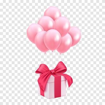 Białe pudełko z niebieską wstążką i balon na różowym tle. minimalna koncepcja nowego roku bożego narodzenia.