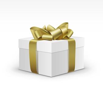 Białe pudełko z żółtą wstążką złota na białym tle