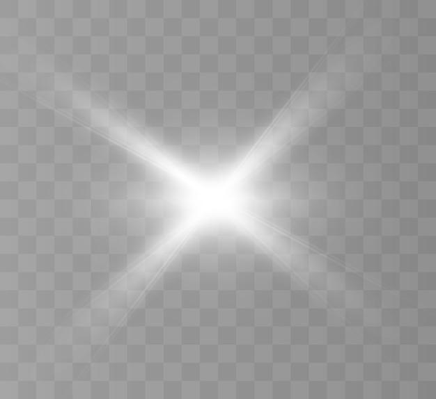 Białe świecące światło wybucha na przezroczystym tle. jasna gwiazda.