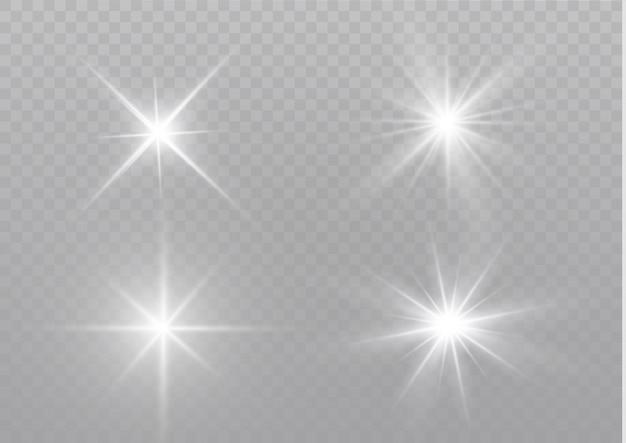 Białe świecące światło wybucha na przezroczystym tle. lśniące magiczne cząsteczki kurzu. jasna gwiazda. przezroczyste świecące słońce, jasny błysk. aby wyśrodkować jasny błysk.
