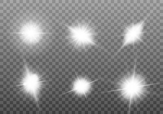 Białe świecące światło. zestaw jasnej gwiazdy. świeci słońce