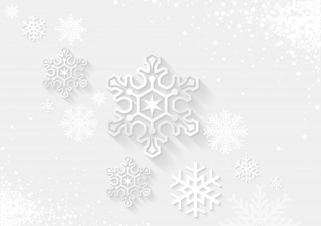 Białe tło boże narodzenie z płatkami śniegu