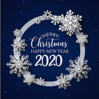 Biało-niebieskie wesołych świąt i kartkę z życzeniami szczęśliwego nowego roku 2020