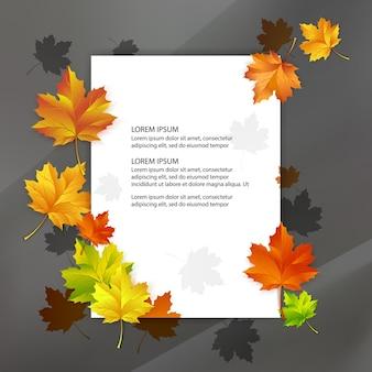 Biały blank ozdobiony kolorowymi jesiennymi liśćmi klonu.