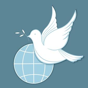 Biały gołąb z gałązką oliwną na tle kuli ziemskiej. koncepcja na dzień pokoju.