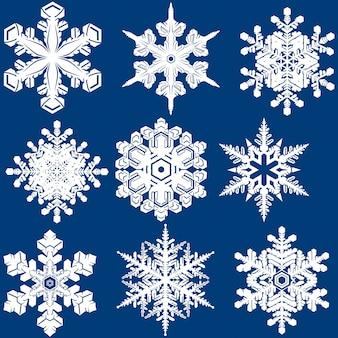 Biały kryształ płatka śniegu na niebiesko