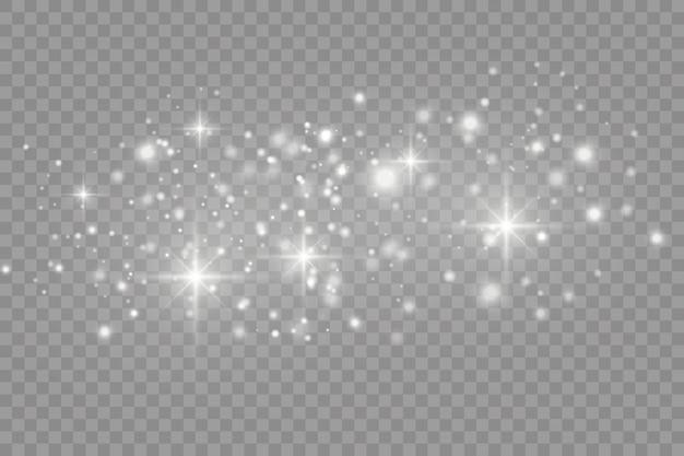 Biały kurz. białe iskry i gwiazdy świecą specjalnym światłem. błyszczy na przezroczystym tle.