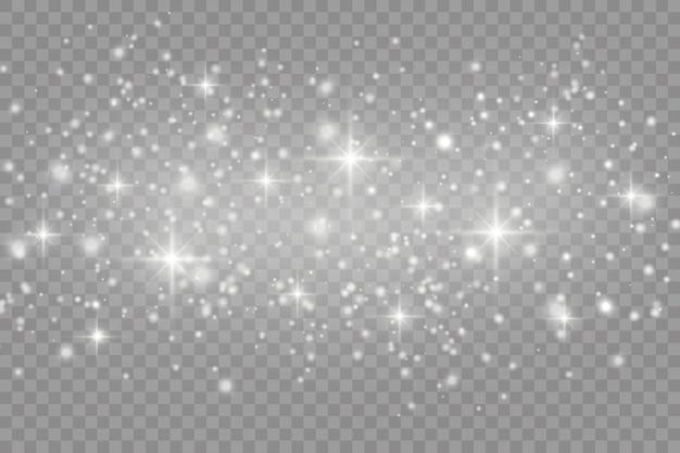 Biały kurz. białe iskry i złote gwiazdy świecą specjalnym światłem. wektor błyszczy na przezroczystym tle. boże narodzenie abstrakcyjny wzór.