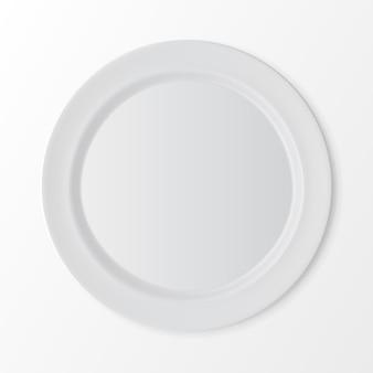 Biały płaski okrągły talerz na białym tle na tle