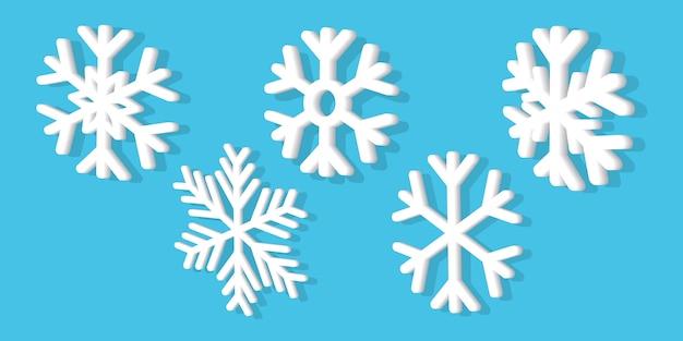 Biały płatek śniegu 3d zestaw realistyczny świąteczny ornament. na białym tle na niebieskim tle.