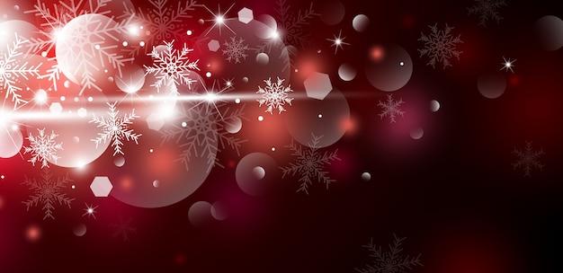 Biały płatek śniegu i śnieg z światłem bokeh na czerwonym sztandarze
