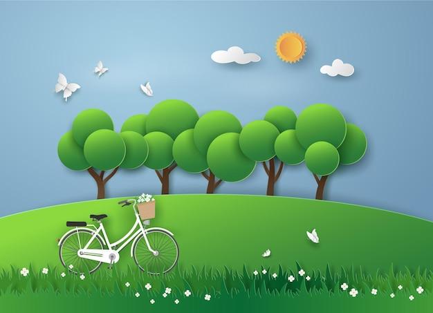 Biały rower na łące w ogrodzie ze świeżym powietrzem w widoku krajobrazu.