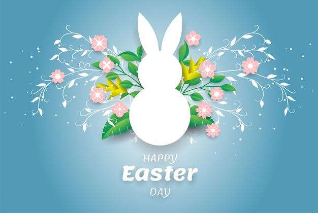 Biały uszaty królik z papierowym liściem i menchiami kwitnie na błękitnym tle.