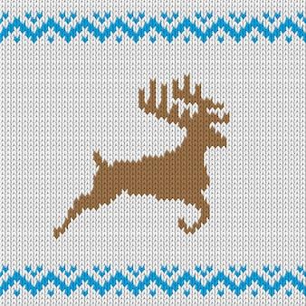 Biały wzór dzianiny z jeleniem