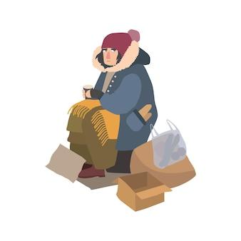 Biedna bezdomna kobieta ubrana w podartą odzież wierzchnią, siedząca na ulicy obok sterty śmieci, trzymająca papierowy kubek i błagająca o pieniądze. postać z kreskówki na białym tle. ilustracja wektorowa.