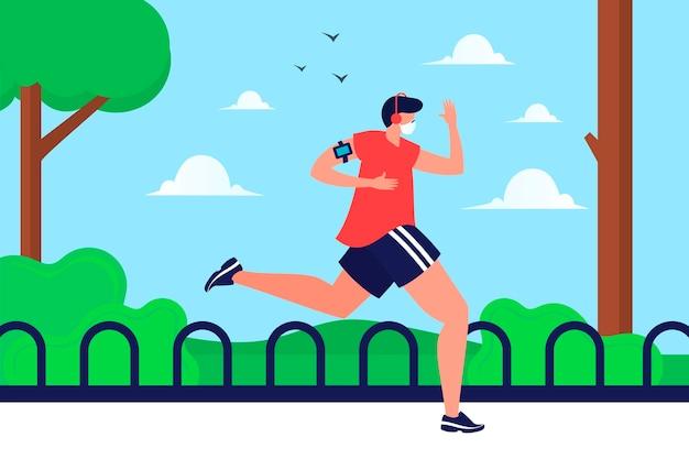 Biegacz z maską medyczną w parku