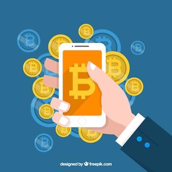 Bitcoin tło z ręki mienia smartphone