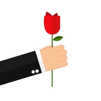 Biznes człowiek ręka trzymać kwiat róży