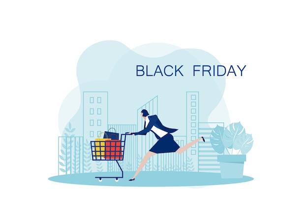 Biznes kobieta działa z wózkiem w czarny piątek, dzień przed bożym narodzeniem na tle miasta.