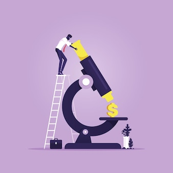 Biznesmen analizy znak dolara pod mikroskopem