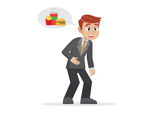 Biznesmen czuje się zmęczony i myśli o jedzeniu