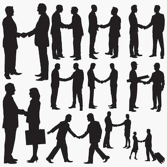 Biznesmen drżenie rąk sylwetki