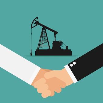 Biznesmen i arabski biznesmen uścisk dłoni rozdajemy olej biznesu