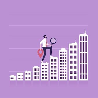Biznesmen idzie w górę rosnące budynki tworzące wykres słupkowy inwestycje w nieruchomości i hipoteka