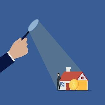 Biznesmen kontroli nieruchomości dla biznesmenów domu i monety