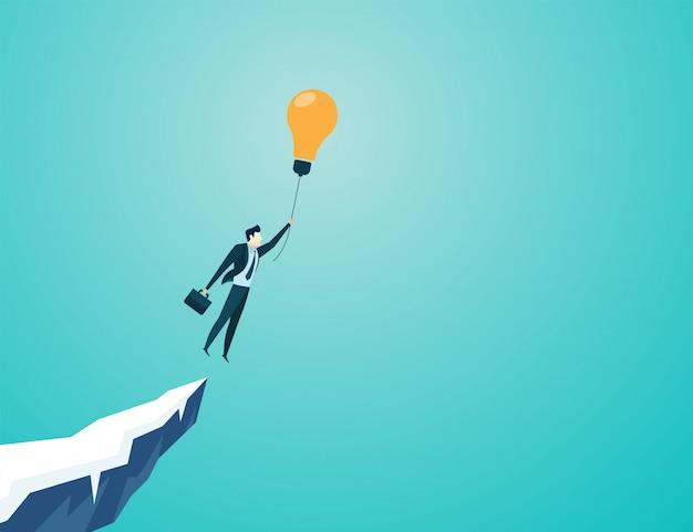 Biznesmen latać z pomysłem blub światła