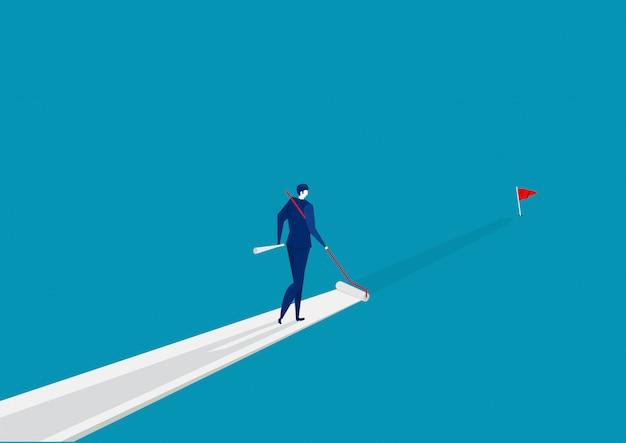 Biznesmen maluje własną drogę do sukcesu na niebiesko.