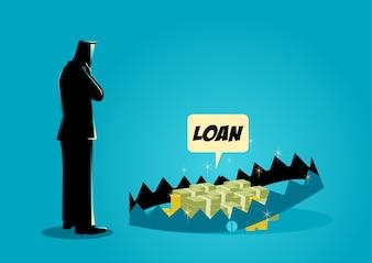 Biznesmen myślenia o zaciągnięciu pożyczek